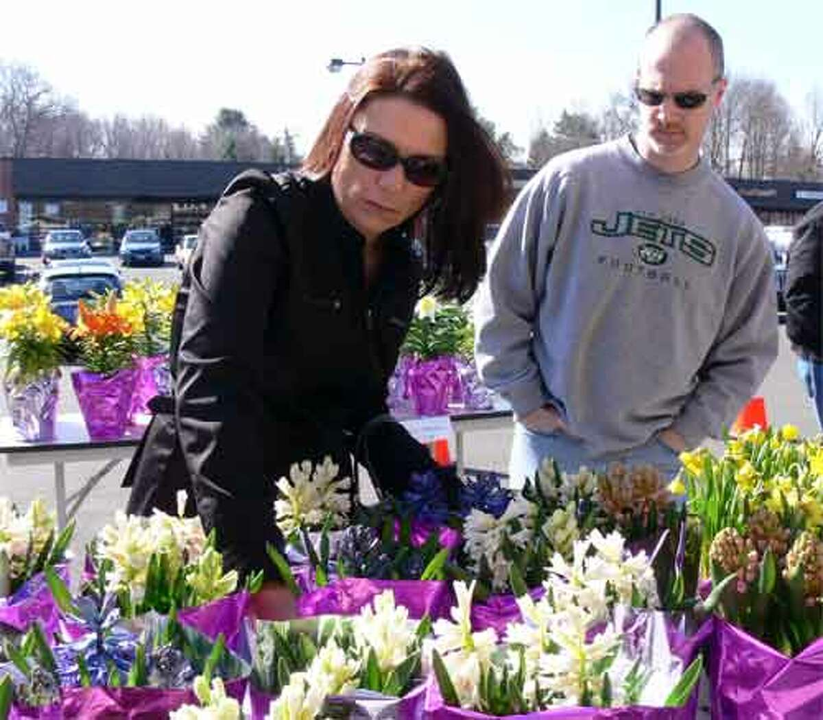 Lynn Dresak and Bruce Wagner of Shelton pick out flowers to buy for the holiday.