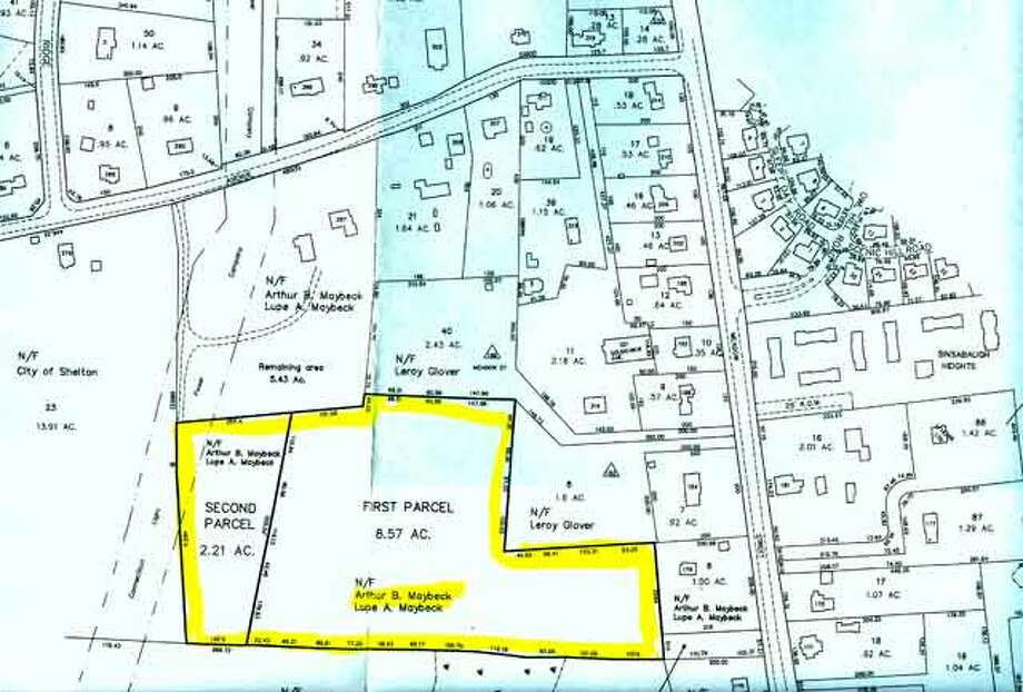 The city has purchased two land-locked parcels from Lupe Maybeck totaling 10.8 acres, which is marked in yellow. In this map, Meadow Street is on the right and Soundview Avenue is on the top.