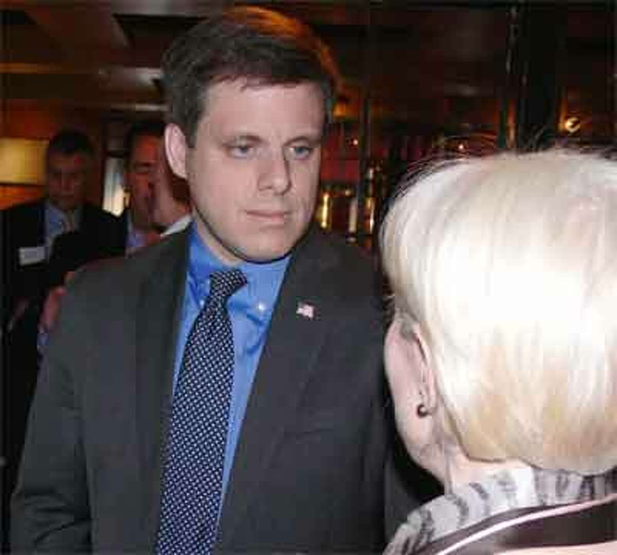 Dan Debicella of Shelton talks to a supporter at a recent campaign event to boost his congressional run.
