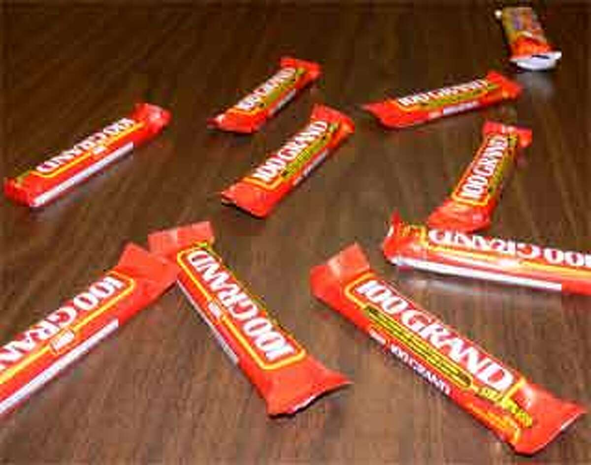 One parent presented candy bars - eight 100 Grand bars for the aldermen and one PayDay bar for Mayor Mark Lauretti - to symbolize the funds needed to begin full-day K and, in her view, the reward it would bring for the city's children.
