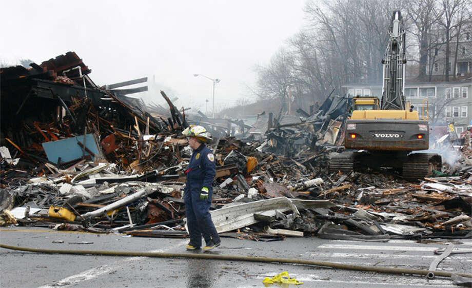 Shelton Fire Marshal James Tortora inspects the Howe Avenue fire scene.