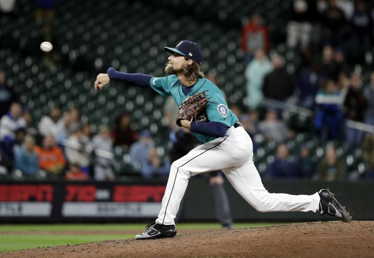 Seattle Mariners starting pitcher Mike Leake throws against the Houston Astros in the ninth inning of a baseball game Wednesday, June 5, 2019, in Seattle. The Mariners won 14-1. (AP Photo/Elaine Thompson)