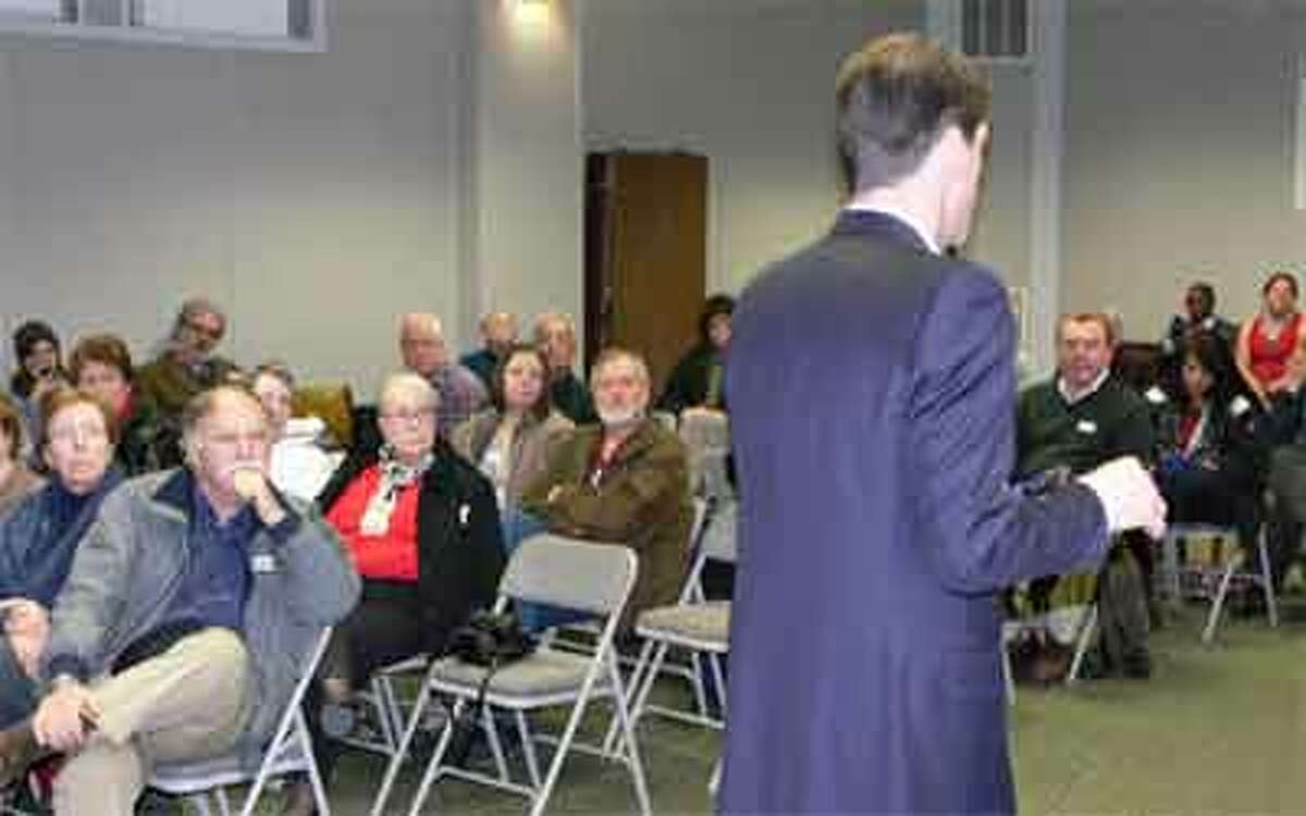 U.S. Rep. Jim HImes talks about various issues during a public meeting in the Shelton City Hall auditorium.
