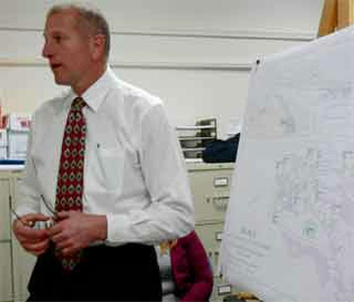 Mayor Mark Lauretti uses maps while arguing there still is a demand for light industrial use in Shelton.