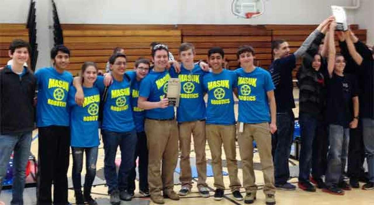 The Masuk High School robotics teams is overseen by William McDonough of Shelton, a longtime teacher at the Monroe school.