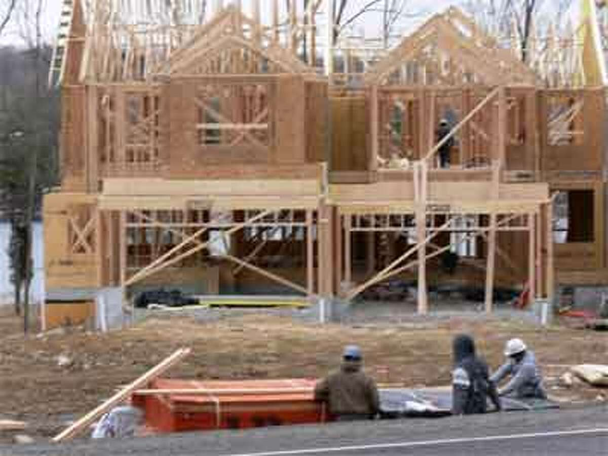Crews work on the model home structure at the Shelton Cove development on Route 110.