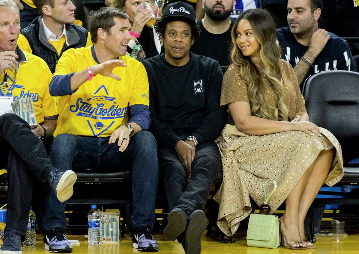 Beyonce Knowles and Jay-Z sit courtside as the Golden State Warriors and Toronto Raptors face off in Game 3 of the NBA Finals at Oracle Arena in Oakland, Calif. Wednesday, June 5, 2019. Today, the rapper announced his partnership with Bay Area-based cannabis brand, Caliva.
