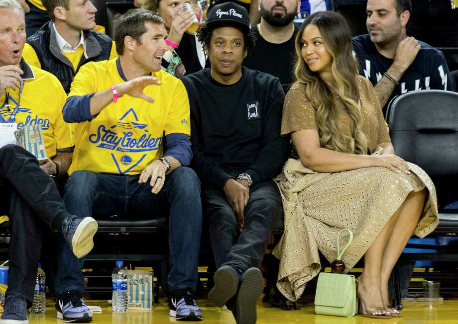 Beyonce Knowles and Jay-Z sit courtside as the Golden State Warriors and Toronto Raptors face off in Game 3 of the NBA Finals at Oracle Arena in Oakland, Calif. Wednesday, June 5, 2019.Today, the rapper announced his partnership with Bay Area-based cannabis brand, Caliva. Photo: Jessica Christian, The Chronicle / ONLINE_YES