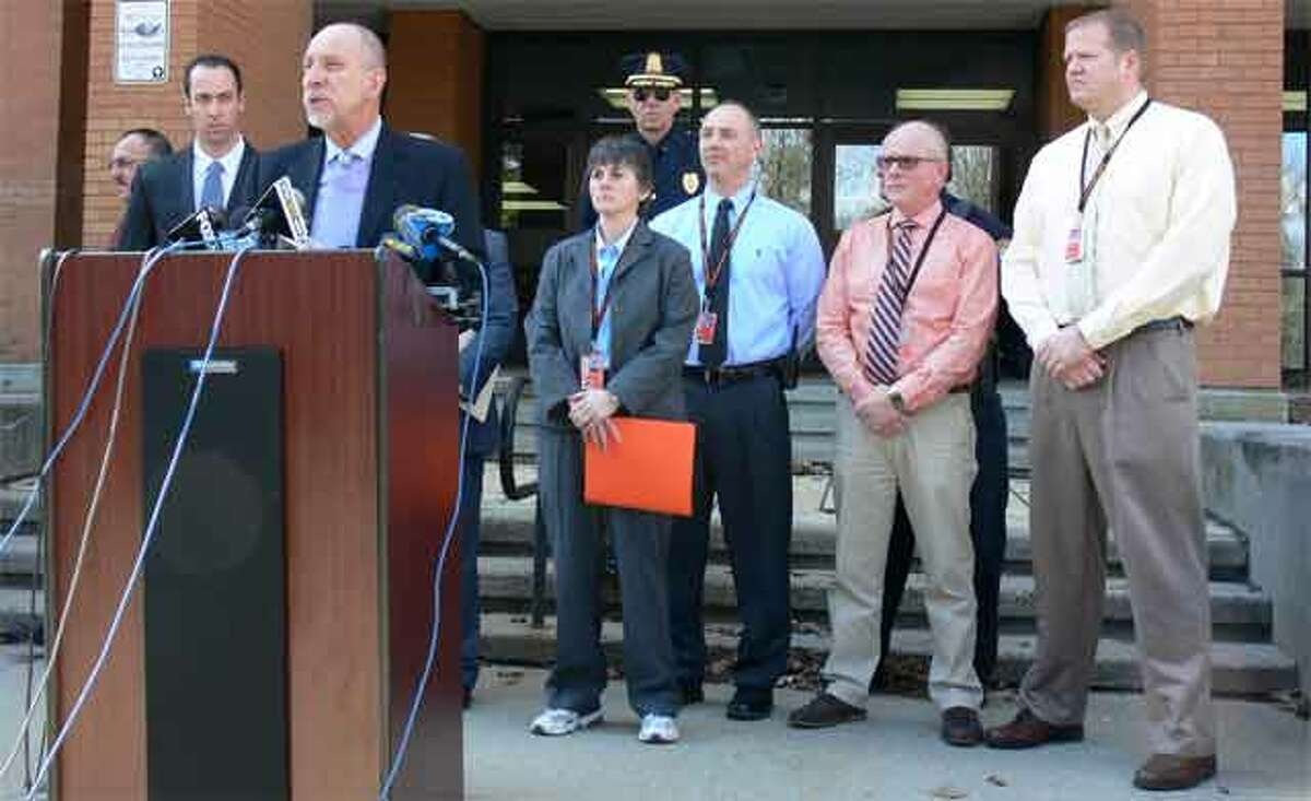 Shelton School Supt. Freeman Burr, surrounded by school and police officials, speaks at a Thursday press conference on the death of Shelton High School student Kristjan Ndoj.