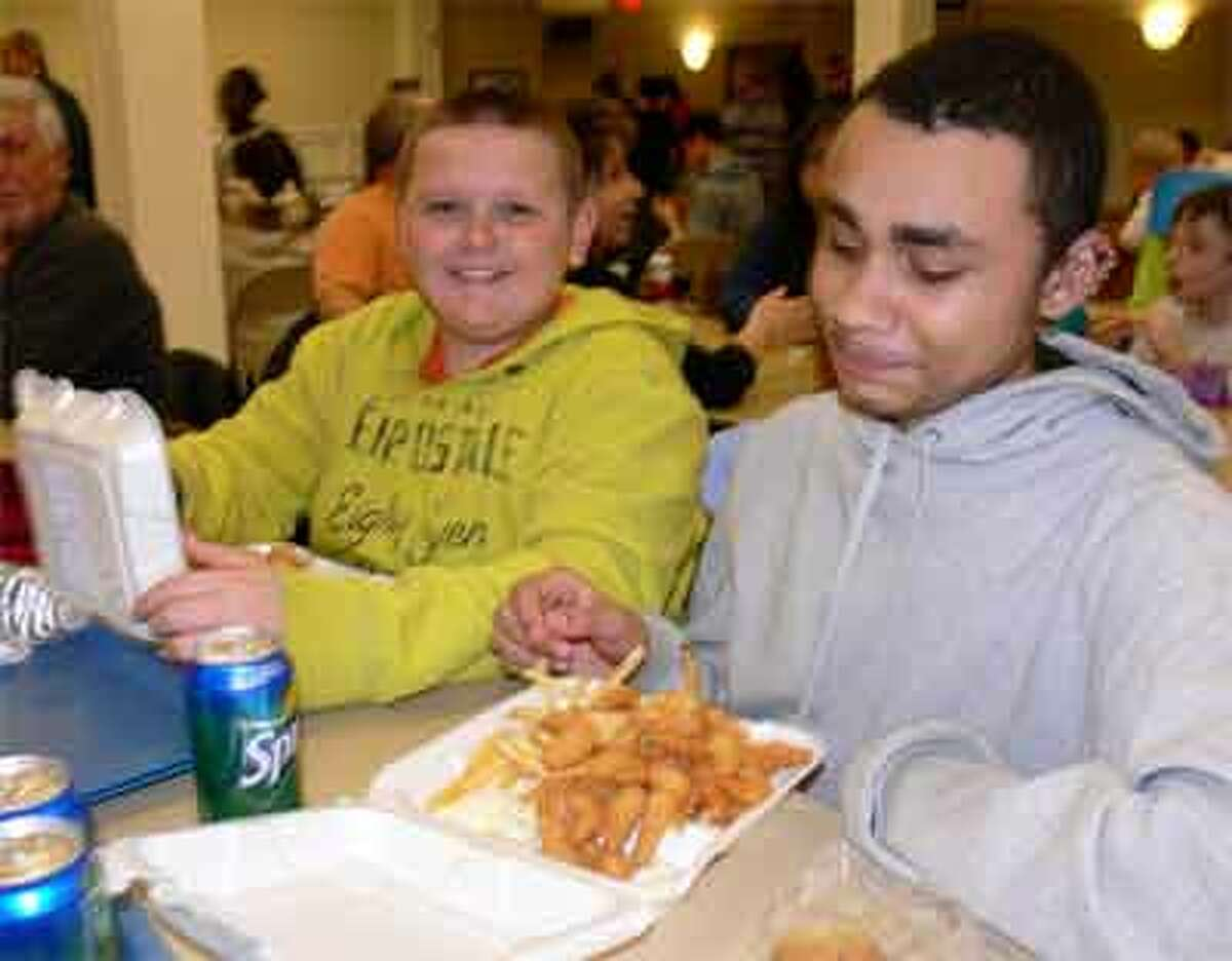 Joe Ciliberth, left, and Alex Boswell, both 14 of Shelton, joined the Couturier family at the St. Joseph fish fry.