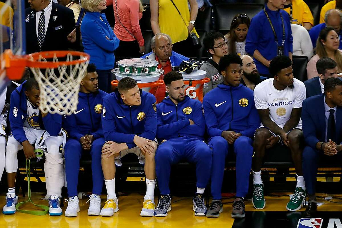 OAKLAND, CALIFORNIA - JUNE 05: Klay Thompson #11 of the Golden State Warriors looks on from the bench against the Toronto Raptors in the second half during Game Three of the 2019 NBA Finals at ORACLE Arena on June 05, 2019 in Oakland, California. NOTE TO USER: User expressly acknowledges and agrees that, by downloading and or using this photograph, User is consenting to the terms and conditions of the Getty Images License Agreement. (Photo by Lachlan Cunningham/Getty Images)