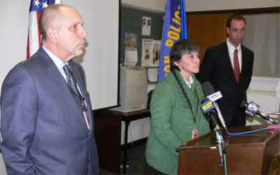 Beth Smith, Shelton High School headmaster, center, speaks at a press conference on Monday morning. On the left is Shelton School Supt. Freeman Burr and on the right, behind her, is Shelton Police Lt. Robert Kozlowsky.