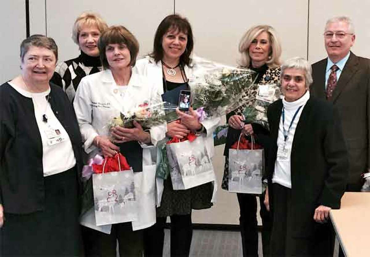Recognizing the donation from Shelton car dealer owner Tom D'Addario are, from left, Sister Cathy Kelly, Cindy Czaplinski, Michelle Donofrio, Nadine Southard, Lyn McCarthy, Sister Louise Macchia, and D'Addario, who also lives in Shelton.