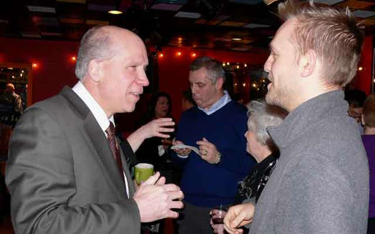 Bill Purcell, Greater Valley Chamber of Commerce president, left, chats with Joshua Elliott, part-owner of the soon-to-open Common Bond Market at the Business After Hours. The Common Bond Market is a natural foods store that will replace the Beechwood Market in Huntington Center.