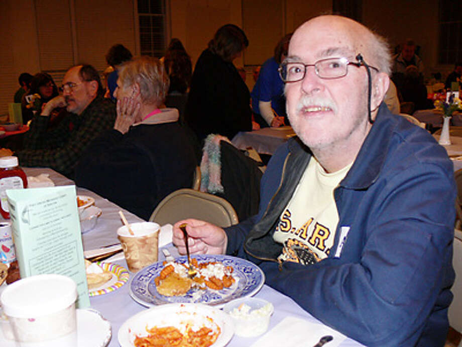 Jim Capinera of Shelton enjoys his meal while at a fish fry dinner last year at First United Methodist Church.