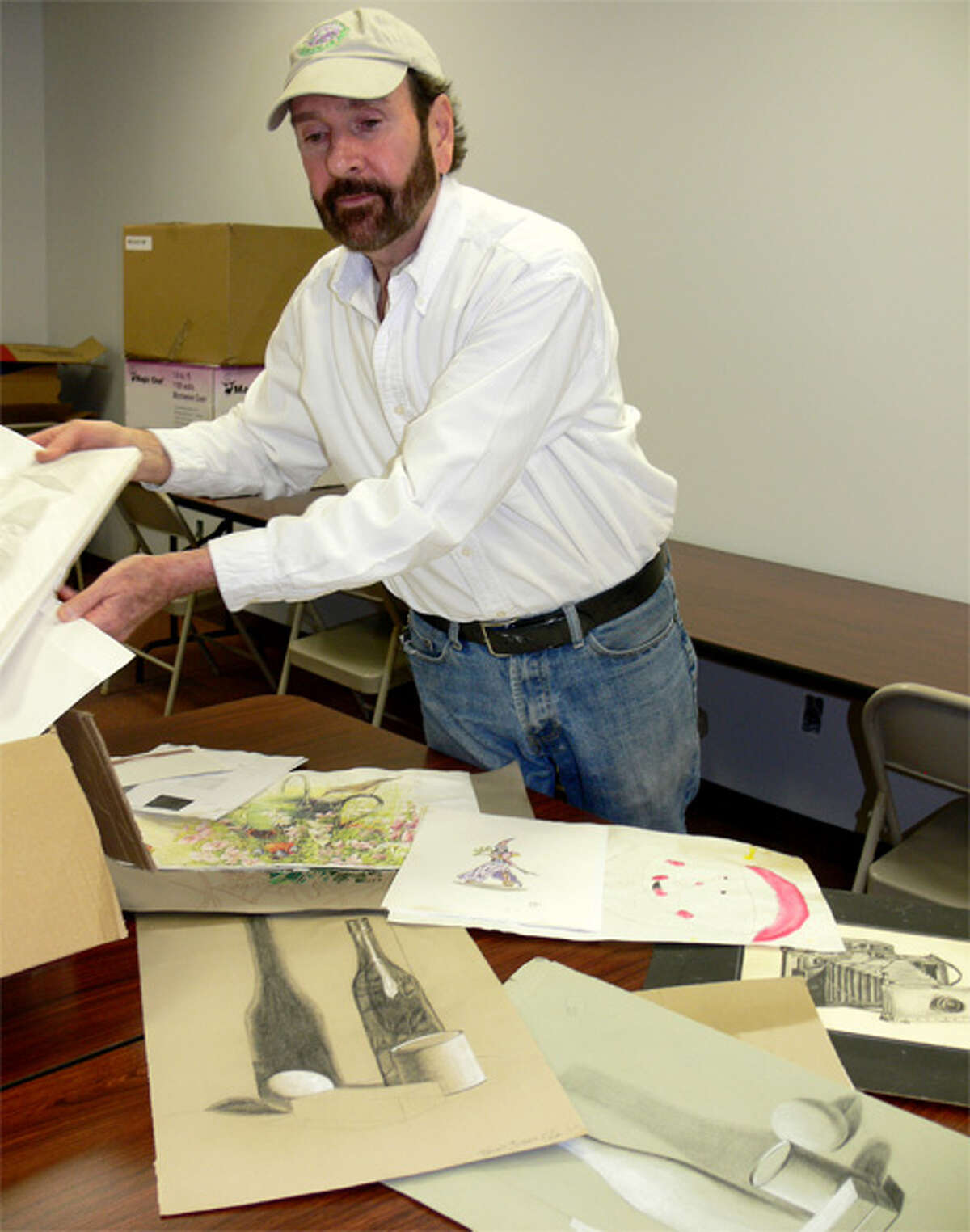 Bob Boroski looks through student artwork that was found in the remnants of the Jan. 6 fire that destroyed his downtown art school facility.