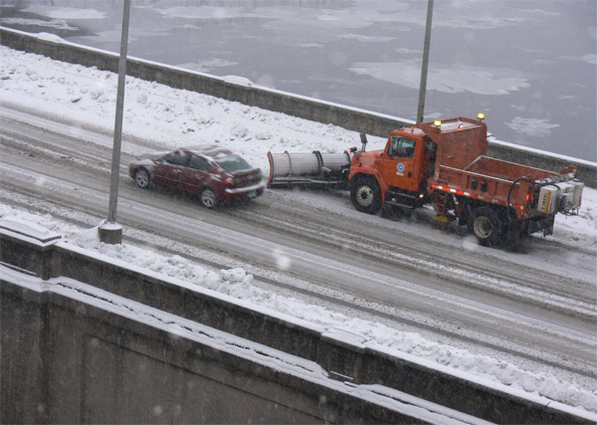 A plow clears snow from the Derby-Shelton Bridge.