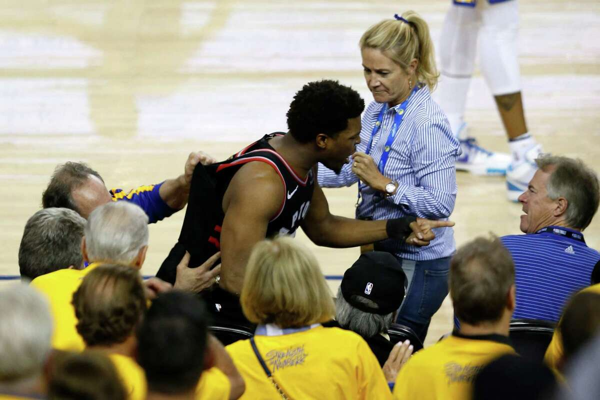 PHOTOS: More from Kyle Lowry's altercation with a Warriors fan Kyle Lowry #7 of the Toronto Raptors yells at a fan in the second half against the Golden State Warriors during Game Three of the 2019 NBA Finals at ORACLE Arena on June 05, 2019 in Oakland, California.