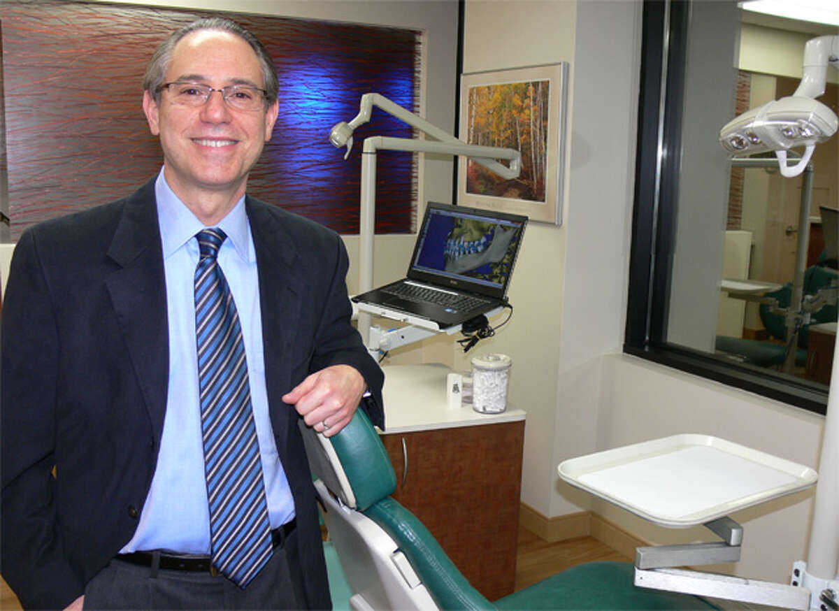 Dr. Mark Feinberg, an orthodontist, inside his new office in the Scinto Towers corporate park in Shelton.