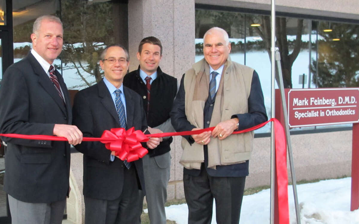 Participating in the ribbon-cutting ceremony at Feinberg Orthodontics in Shelton are, from left, Mayor Mark Lauretti, Dr. Mark Feinberg, Robert Scinto Jr. and Robert Scinto.