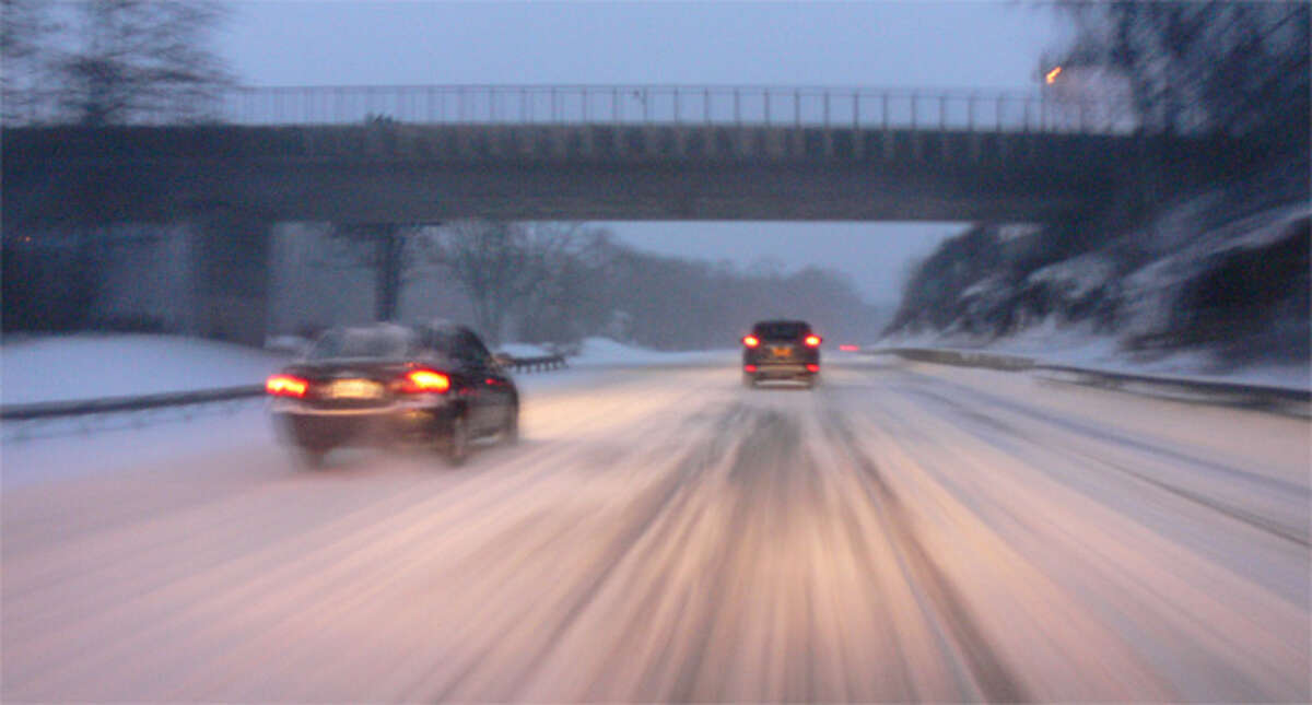 Cars travel south on Route 8 in Shelton on Friday morning.