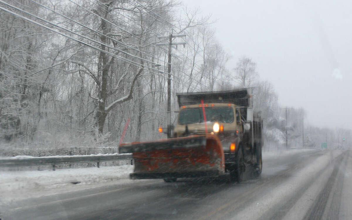 A snowplow travels on Bridgeport Avenue in Shelton.