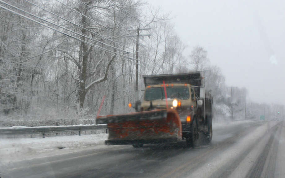 A snowplow travels on Bridgeport Avenue in Shelton.