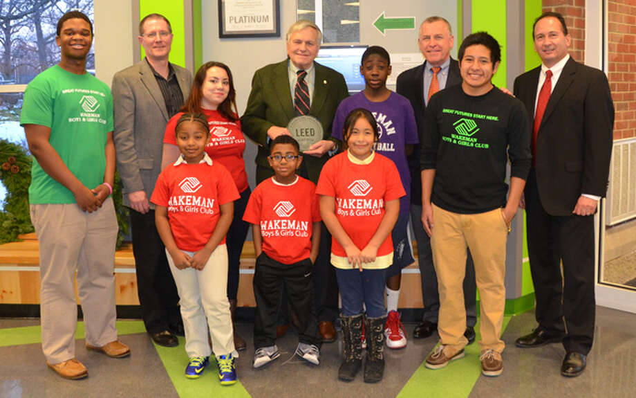 Joining the award ceremony are, from left, front row, Wakeman clubhouse members Jayvon Snider, Jannette Latorre, Jasiyah Scott, Tyler Lopez, Paola Chaves, Haniel Jeremy, and Billy Narvaez; back row, Pat Rose of Rose-Tiso & Co.; Joel Smilow, philanthropist; Dick Galvin, chairman, Wakeman Boys & Girls Club board of trustees; and Shelton resident Peter Zannis of Turner Construction.
