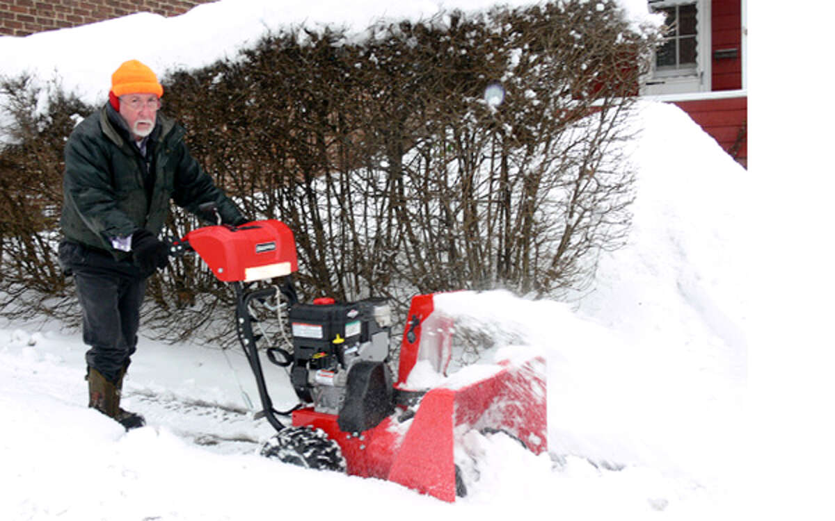 Bill Gazsi uses a snowblower on Wednesday morning to clear the sidewalk in front of his Center Street home in Shelton.