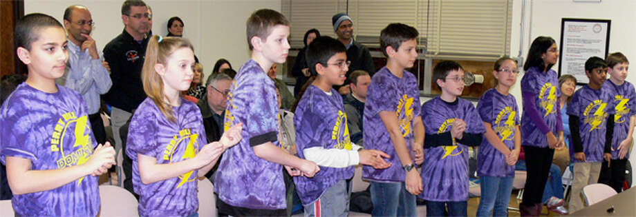Members of the Perry Hill Dominators stand up to be congratulated by the Shelton Board of Education for winning a state robotics championship.