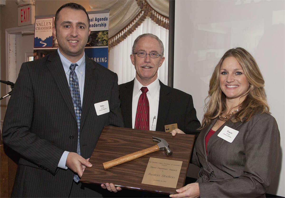 Mike Pasich, left, and Tracie Schock, right, both of Avalon Shelton, hold the Greater Valley Chamber of Commerce's Silver Hammer Award while posing with Phil White, chamber board chairman.