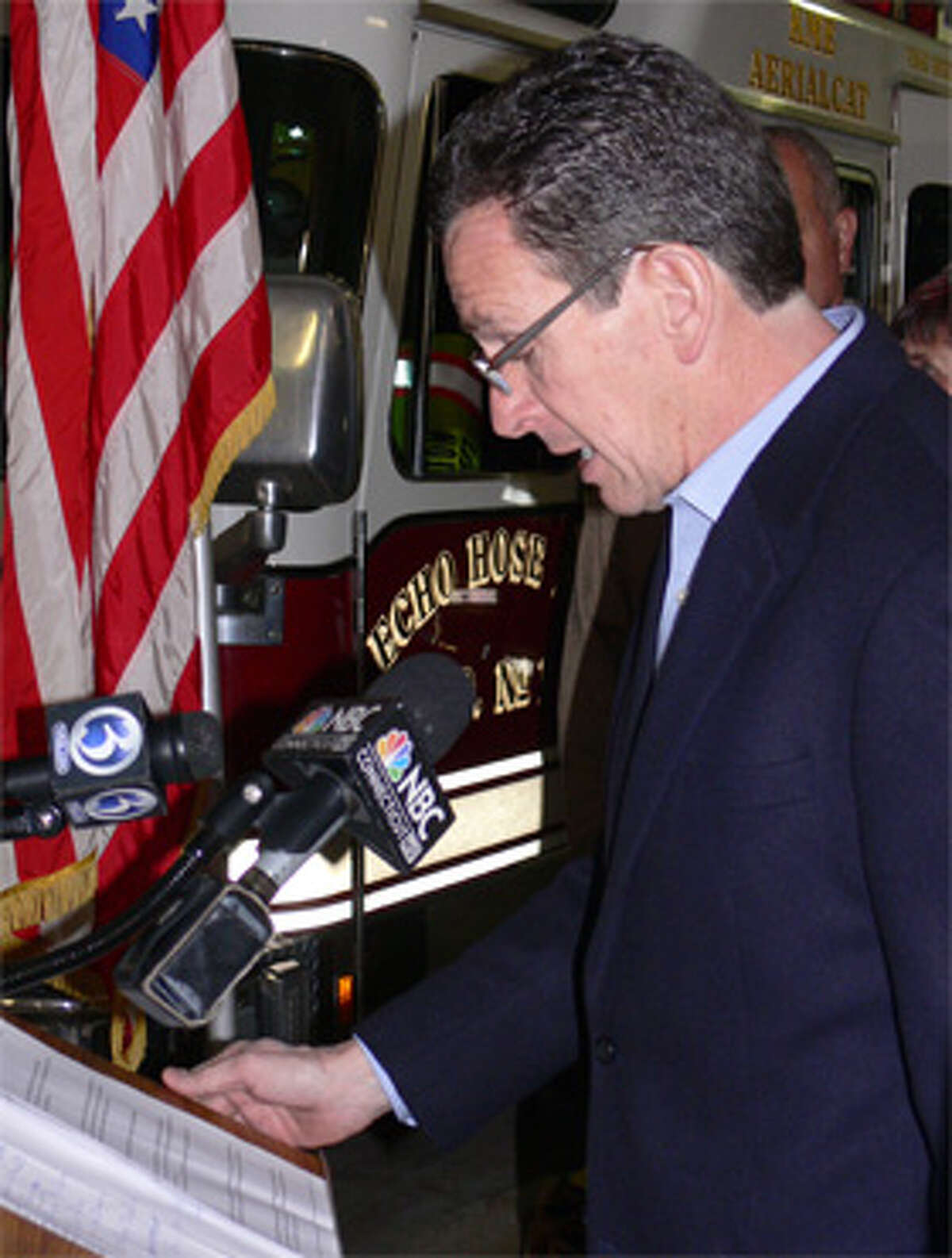 Gov. Dan Malloy talks about assistance efforts for victims of the Jan. 6 Shelton fire at the Echo Hose firehouse.