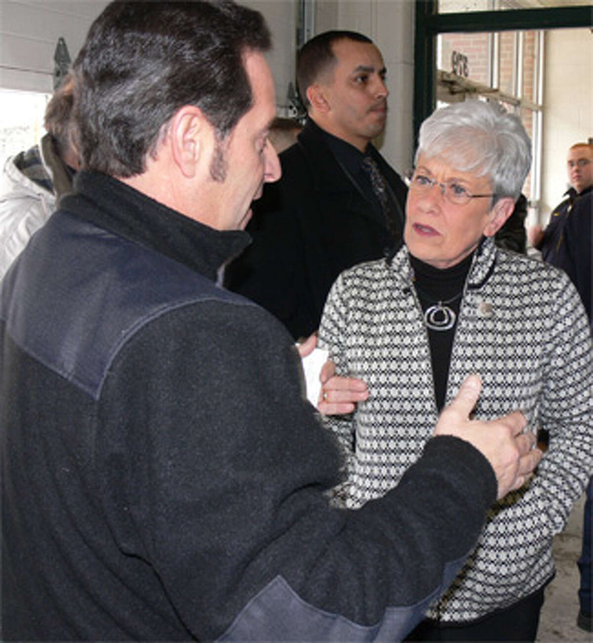 Frank Cirillo, business manager of the International Brotherhood of Electrical Workers Local 420, talks with Lt. Gov. Nancy Wyman during the event at the firehouse.