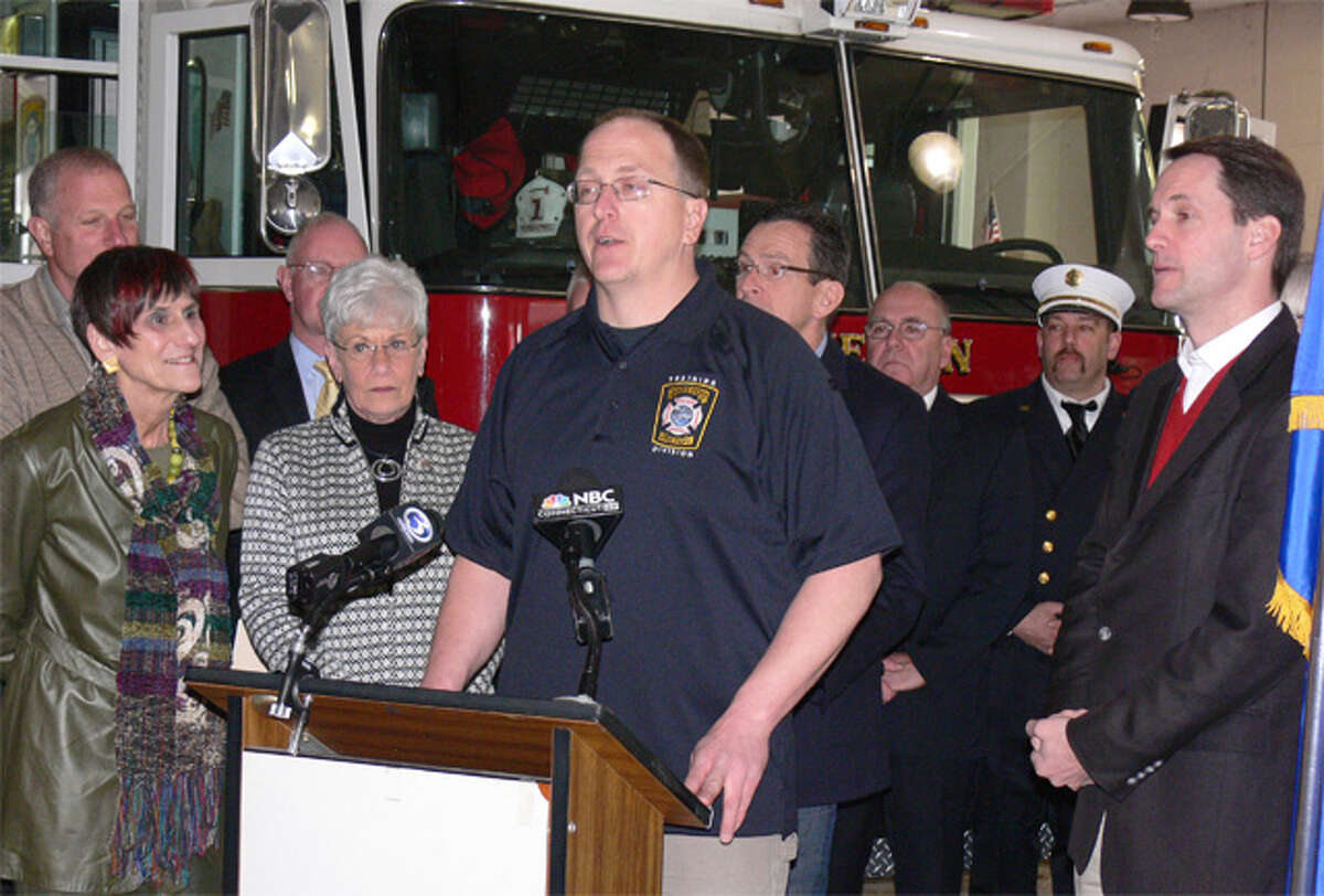 Echo Hose firefighter Kevin Lantowsky, center, speaks at a press event on fire disaster relief Saturday in Shelton while surrounded by public officials such as Mayor Mark Lauretti, U.S. Rep. Rosa DeLauro, Lt. Gov. Nancy Wyman, Gov. Dannel P. Malloy and U.S. Rep. Jim Himes.