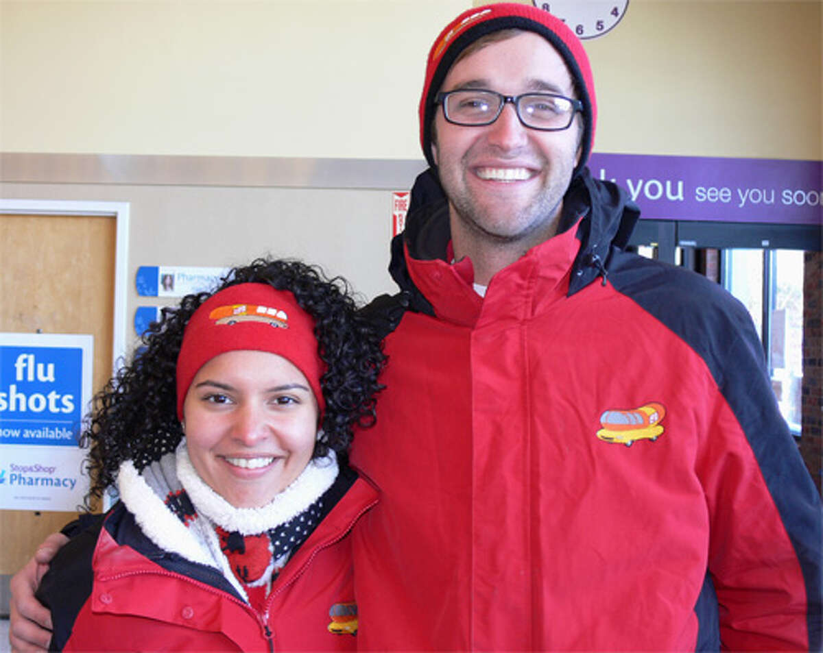 Amanda Vazquez and Michael Tierney wear their official Oscar Mayer Wienermobile outfits - from headband and hat to jackets - while visiting the Stop & Shop in Shelton.