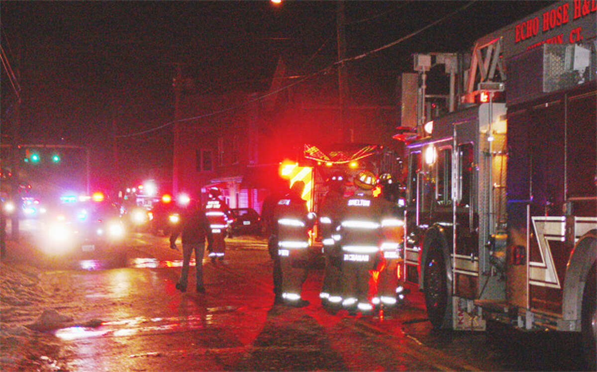 Firefighters at the scene of the Jan. 22 fire a multifamily structure in downtown Shelton.
