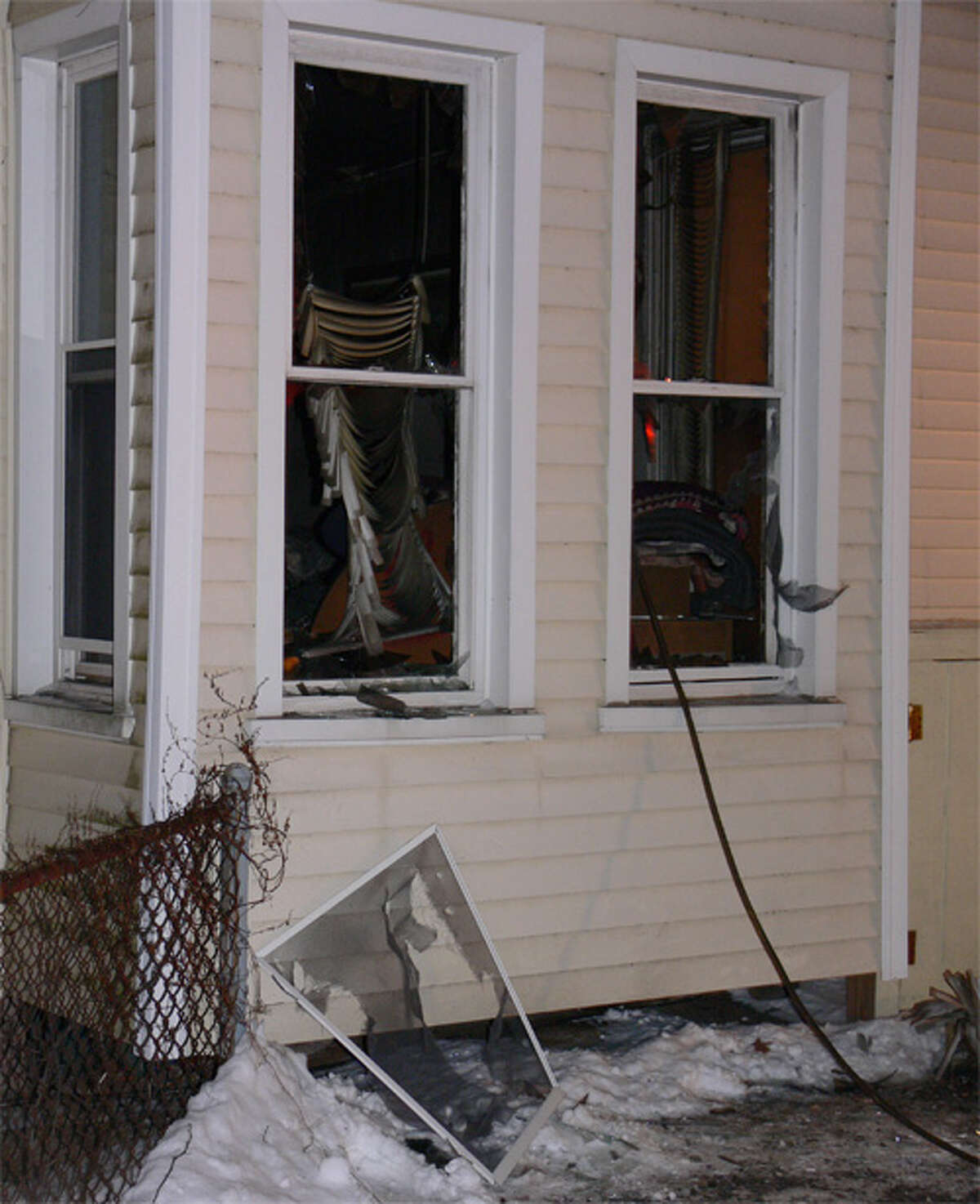 Smashed windows at the fatal Howe Avenue fire on Wednesday evening.