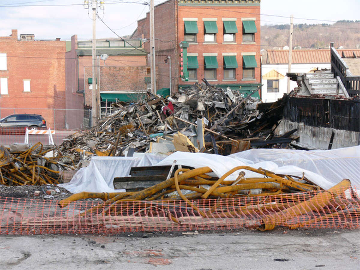 A view of the debris pile from the fire, which includes a lot of piping material, taken from the post office parking lot in downtown Shelton.
