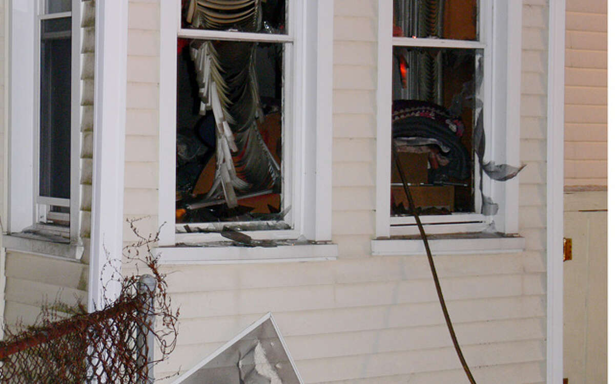 First-floor windows were smashed during firefighting efforts at 593 Howe Ave. in downtown Shelton on Wednesday evening.