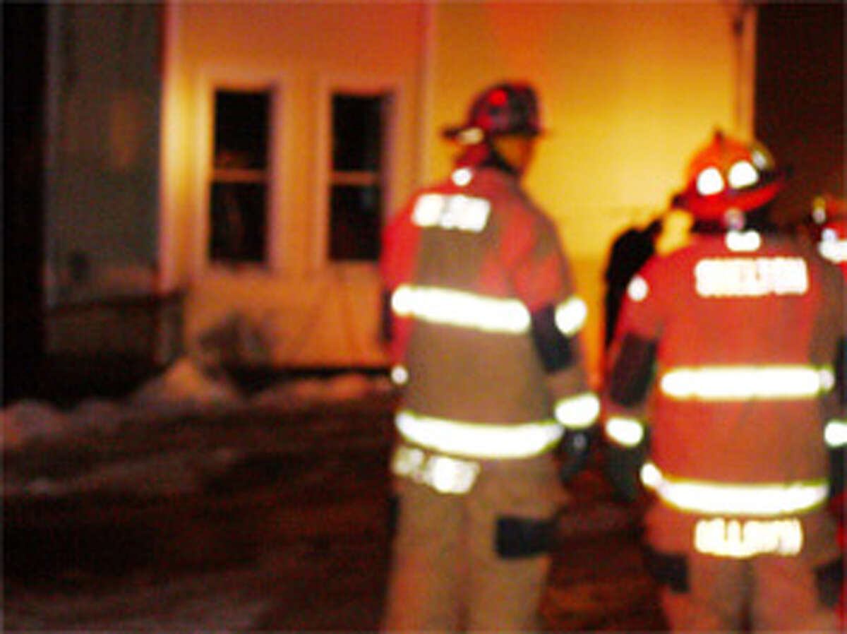 Firefighters at the scene of the 593 Howe Ave. fire on Wednesday night.