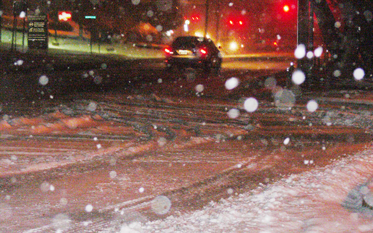 A car travels north on Bridgeport Avenue in Shelton at about 6 p.m. on Tuesday, at the height of the snowstorm.