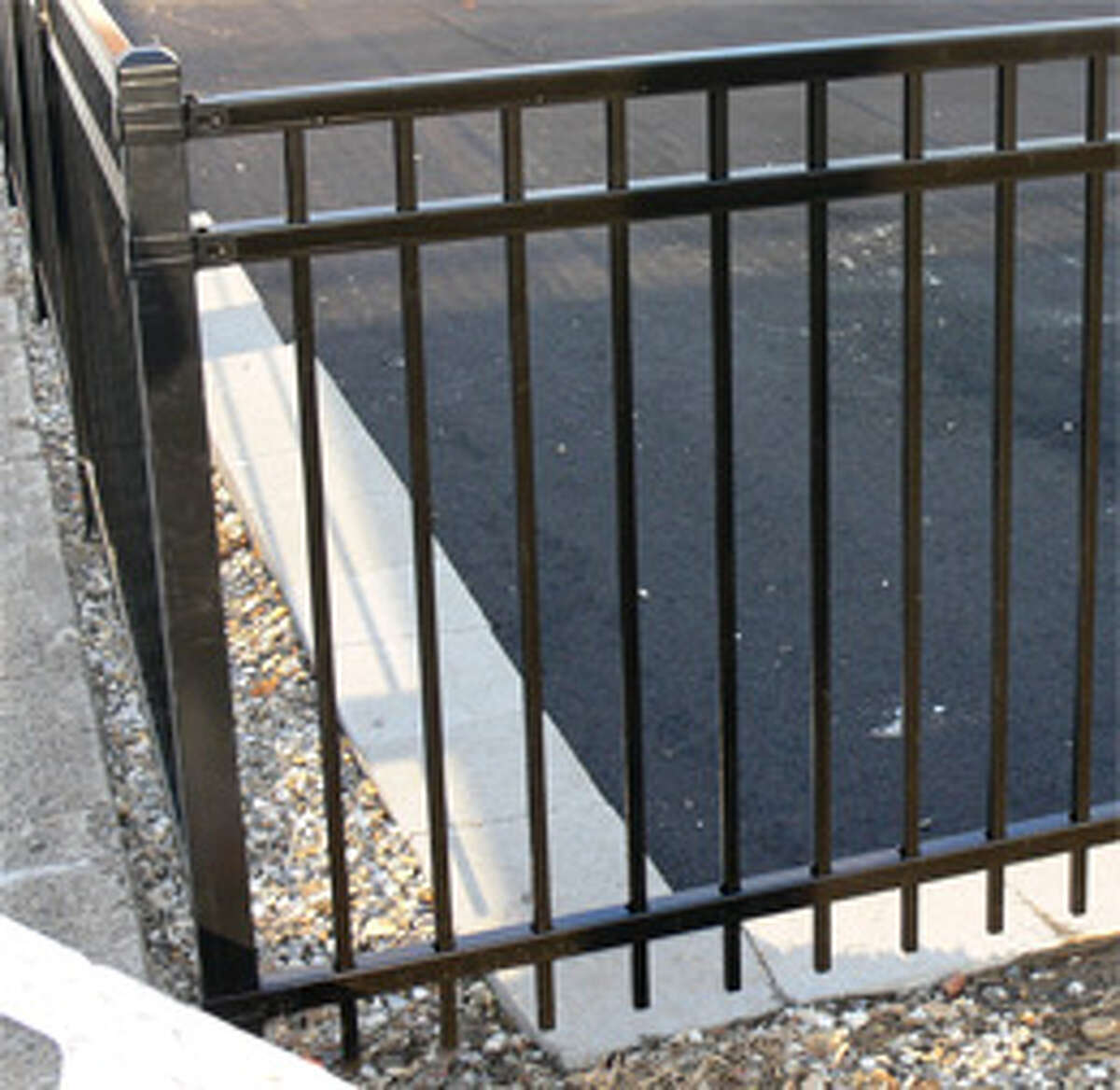 Decorative black fencing has been placed around the new Plumb Memorial lot.