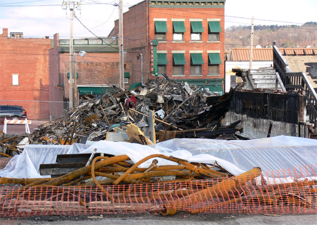 A view of the debris pile, which includes a lot of piping material, taken on Friday afternoon from the post office parking lot in downtown Shelton.
