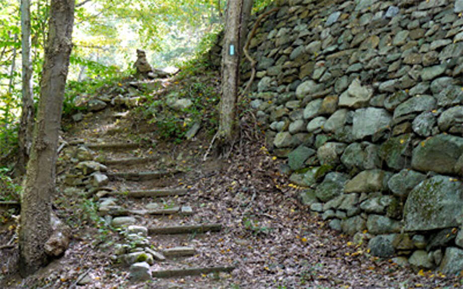A new section of trail skirts a retaining wall built during the Great Depression at Indian Well State Park in Shelton.