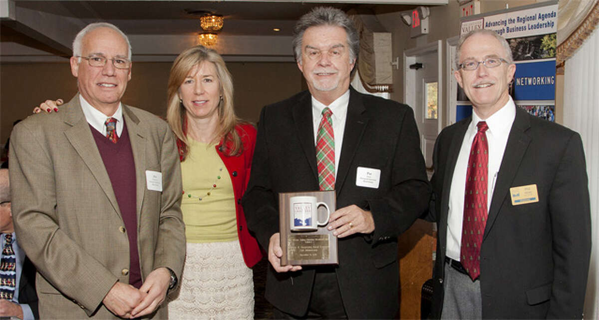 Pictured from left are Jim Guarrera of Carey & Guarrera Real Estate Associates, Donna Bak of Sandler Training, Pat Carey of Carey & Guarrera, and Phil White, Greater Valley Chamber of Commerce board chairman.