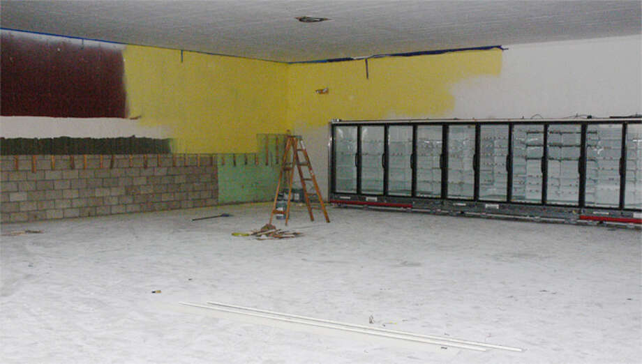 The inside of the former Beechwood Market has essentially been stripped to make way for new fixtures, such as the installed refrigerator and freezer units shown in the rear.