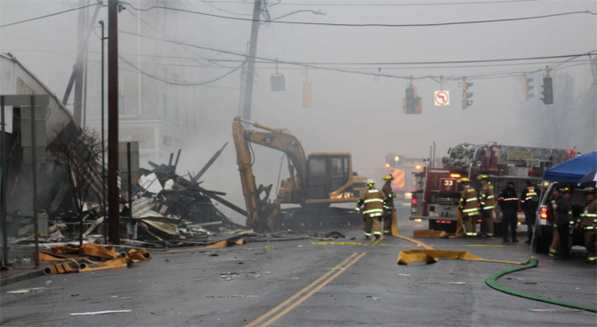 The smoke-filled scene on Howe Avenue about seven hours after the fire broke out.