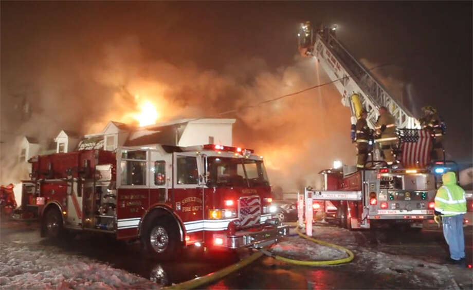 Shelton firefighters battle the late-night fire on Howe Avenue in January 2014.