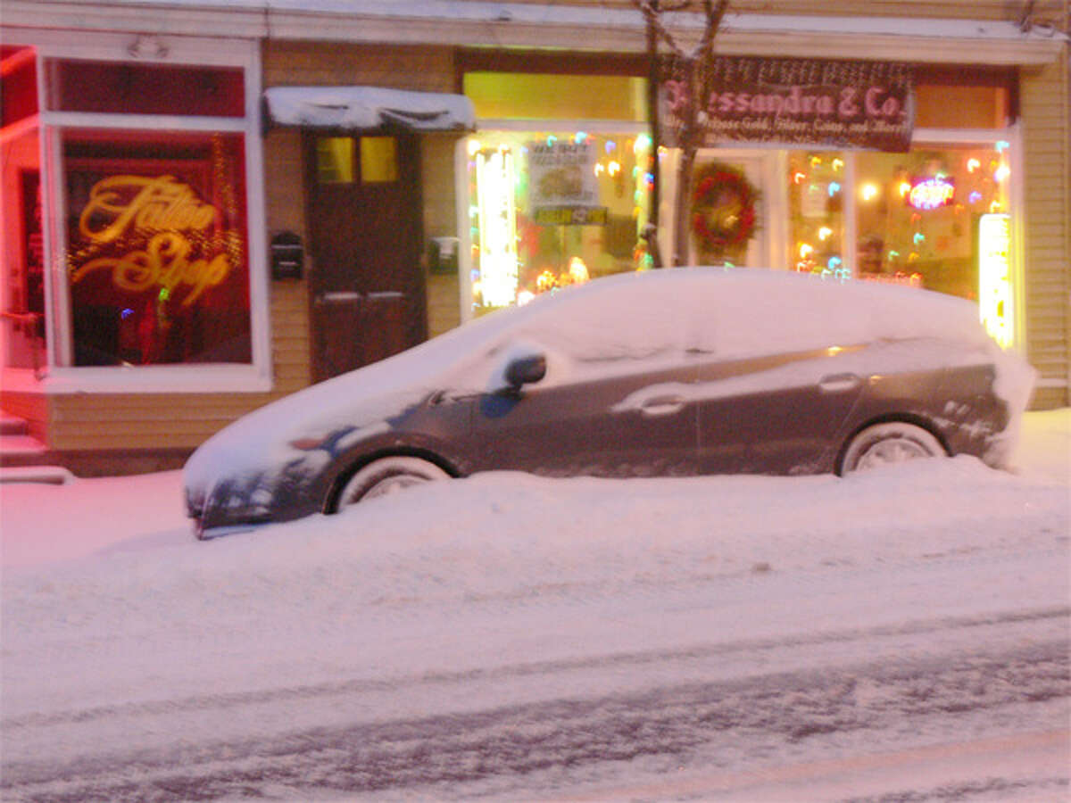 A snow-covered vehicle on Center Street in downtown Shelton on Friday morning.