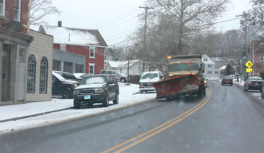 A snowplow on Center Street in downtown Shelton on Thursday morning, at the beginning of the snowstorm.